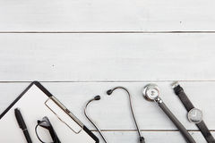 Workplace of doctor - stethoscope, medicine clipboard, glasses a Stock Photography