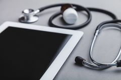 Workplace doctors. Doctor tablet medical healthcare computer stethoscope royalty free stock photography