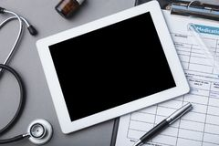 Workplace doctors. Doctor tablet medical healthcare computer stethoscope stock photography