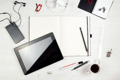 Workplace. Empty notepad, tablet pc and smart phone on white wooden table stock photos