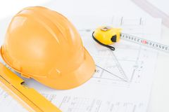 Workplace of engineer. Image of a typical engineer workplace with blueprint, hardhat and measuring tools stock image