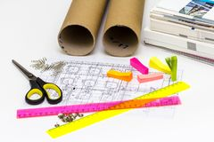 Workplace engineer has the blueprints, scissors, rulers, sticker stock photo