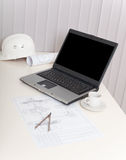 Workplace of engineer with laptop Royalty Free Stock Image