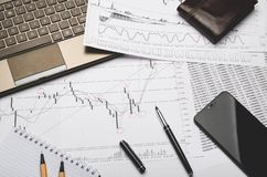 The workplace of the financier, graphics on paper, analysis forex royalty free stock photography