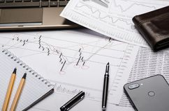 The workplace of the financier, graphics on paper, analysis forex royalty free stock photos