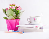 Workplace with flower books and a coffee cup with text Stock Photos
