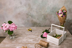Workplace with flowers, bouquet and rope Stock Image
