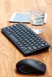 Workplace and glass of water Royalty Free Stock Photo