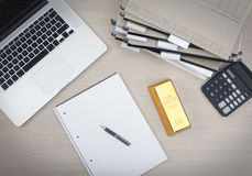 Workplace with a gold bar Royalty Free Stock Photography