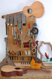 Workplace of the guitar master. The master is engaged in manufacturing of guitars, repair and restoration of string tools, violins, domras, guitars, balalaikas Stock Image