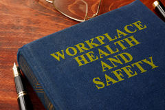 Workplace health and safety WHS. Title Workplace health and safety WHS on the book stock image
