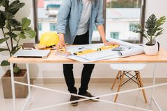 Workplace items tools for project, Architect or Engineer working on blueprint for architectural project in progress, construction stock photos