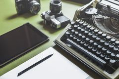 Workplace Of A Journalist, Writer, Blogger. Analog Typewriter, Digital Tablet And Film Camera On The Green Table stock image