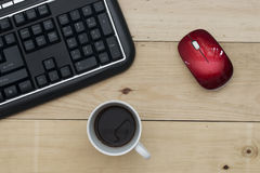 Workplace, keyboard mouse and coffee on wood table Royalty Free Stock Photos