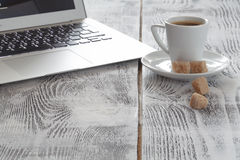 Workplace with laptop and coffeecup on white Royalty Free Stock Images