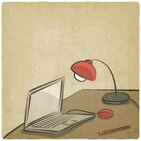 Workplace laptop lamp old background Stock Photos