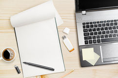 Workplace. Laptop and notepad on wooden table royalty free stock photography