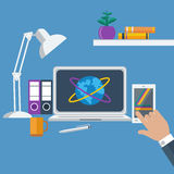 Workplace with laptop, smartphone, office objects Stock Photo
