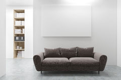 Workplace lounge, brown sofa. Workplace lounge with a long and comfortable brown sofa, a horizontal poster and a bookcase in the background. 3d rendering, mock Royalty Free Stock Photo