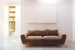 Workplace lounge, brown sofa, toned. Workplace lounge with a long and comfortable brown sofa, a horizontal poster and a bookcase in the background. 3d rendering Stock Photo