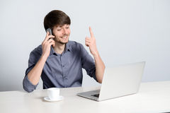 Workplace man with notebook. And mobile phone Stock Image