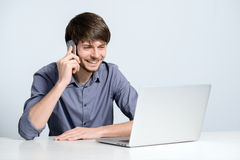 Workplace man with notebook. And mobile phone Stock Photography