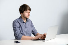 Workplace man with notebook. And mobile phone Royalty Free Stock Images