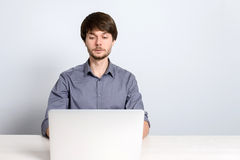 Workplace man with notebook. And mobile phone Royalty Free Stock Photography