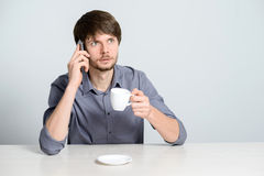 Workplace man with notebook. And mobile phone Royalty Free Stock Image