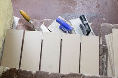 A workplace for a master from laying tiles. Tools and accessorie. S as well as tiles when laying. Laying tiles on the stairs Stock Photography