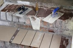 A workplace for a master from laying tiles. Tools and accessorie. S as well as tiles when laying. Laying tiles on the stairs Stock Images