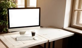 Workplace with modern computer on the desk. Workplace with modern computer with big display on the desk stock photo