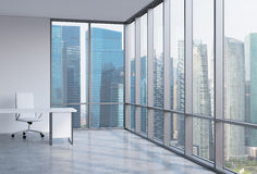 A workplace in a modern corner panoramic office. Business district in Singapore. Stock Image