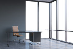 A workplace in a modern corner panoramic office, copy space on windows. A brown leather chair and a black table. A concept of fina Stock Photography