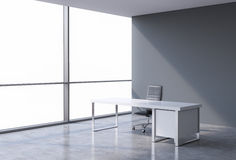 A workplace in a modern corner panoramic office, copy space on windows. A concept of financial consulting services. Stock Photo