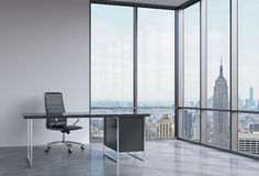 A workplace in a modern corner panoramic office in New York, Manhattan. A black leather chair and a black table. A concept of fina. Ncial consulting services. 3D Stock Photos