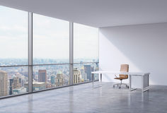 A workplace in a modern corner panoramic office in New York, Manhattan. A brown leather chair and a white table. A concept of financial consulting services. 3D Stock Photo