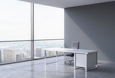 A workplace in a modern corner panoramic office in New York, Manhattan. A concept of financial consulting services. Stock Images