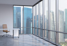 A workplace in a modern corner panoramic office in Singapore. A concept of financial consulting services. Stock Photos
