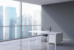 A workplace in a modern corner panoramic office in Singapore. A concept of financial consulting services. 3D rendering Stock Image