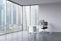 A workplace in a modern corner panoramic office with Singapore view.  Royalty Free Stock Images