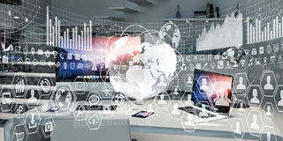 Workplace with modern devices and hologram screens 3D rendering Stock Photography