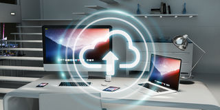 Workplace with modern hologram cloud icon 3D rendering. Office with modern devices and digital cloud icon floating 3D rendering Royalty Free Stock Photography