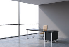A workplace in a modern panoramic office, copy space view from the windows. A concept of financial consulting services. Royalty Free Stock Photos