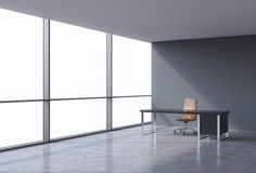 A workplace in a modern panoramic office, copy space on windows. A brown leather chair and a black table. A concept of financial consulting services. 3D Stock Photo