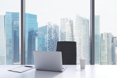 A workplace in a modern panoramic office with Singapore view. Stock Image
