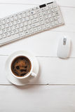 Workplace with mouse, coffee and keyboard Stock Image