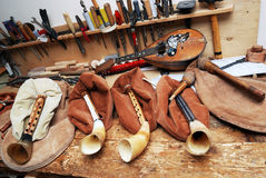 Workplace musical masters, bagpipes, mandolin, tools Royalty Free Stock Photo