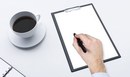 Workplace, note pad and coffee Royalty Free Stock Images