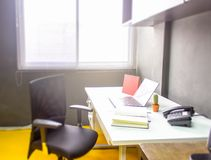 Workplace with notebook laptop work table in office windows stock images